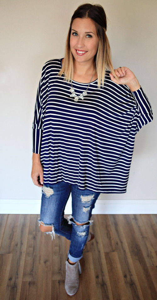 Navy and white stripe dolman top with distressed jeans and grey booties