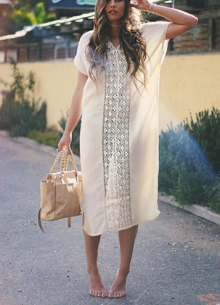 The Maise Cover Up is an off white boho cover-up maxi.