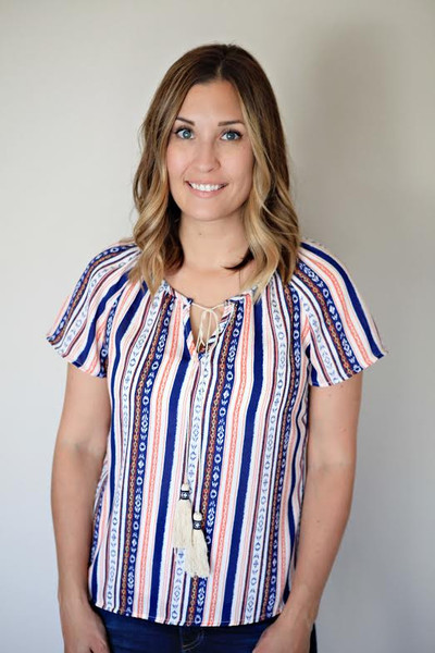The Tulum Top is a colorful striped short sleeve boho tassel top.