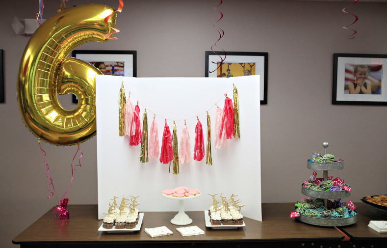 Gymnastics party with silhouette cake toppers, leotard cookies, and jump rope favors