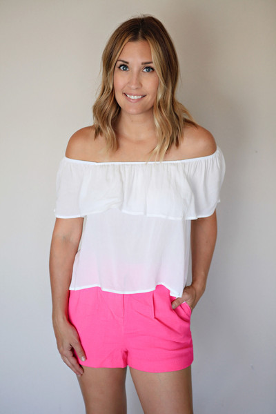 The Lindsey Top is a white off shoulder boho style top.