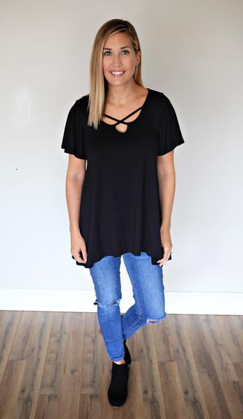 The Finley Top is a black criss cross short sleeve top.