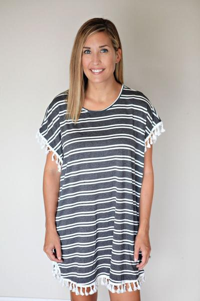 The Taylor Tassel Tunic is a charcoal and white stripped short sleeve tunic (or coverup) with tassels.